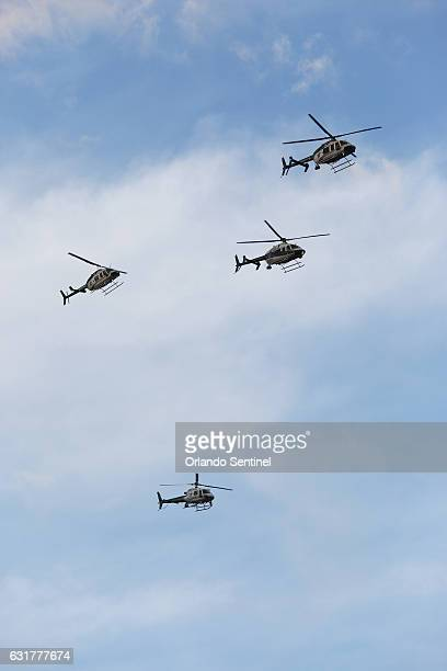 Helicopters do a flyover in a missing man formation during funeral services for Deputy First Class Norman Lewis on Sunday Jan 15 2017 at First...