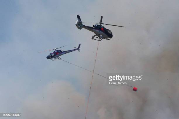 Helicopters fight the new fire in Walters Bluff Nelson as forest fires continue to burn across the Tasman District on February 8 2019 in Richmond...