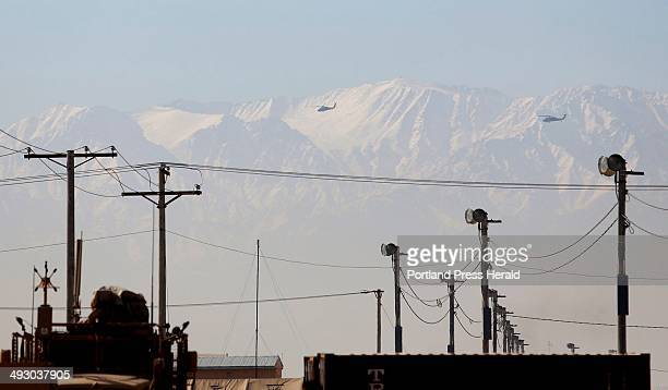 Helicopters fly over Bagram Airfield in Afghanistan against the backdrop of snowy mountains Friday December 20 2013