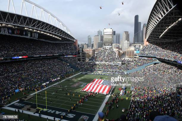 Helicopters fly over during the national anthem before the game between the Seattle Seahawks and the Washington Redskins before the NFC Wild Card...