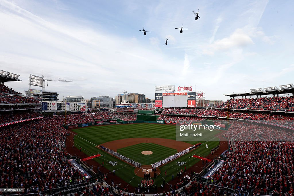 Helicopters fly over during the national anthem prior to game one of the National League Division Series between the Los Angeles Dodgers and the Washington Nationals at Nationals Park on October 7, 2016 in Washington, DC.