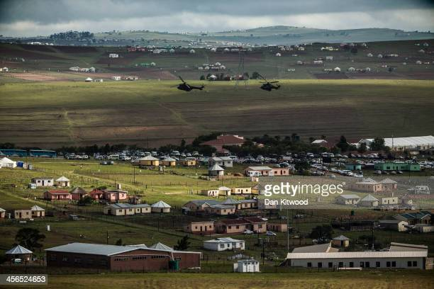 Helicopters fly over Qunu as former South African President Nelson Mandela's funeral cortege arrives at his family's rural home December 14 2013 in...