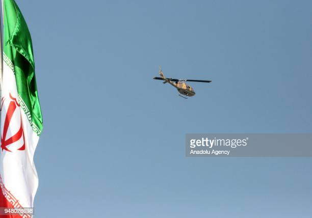 Helicopters fly over the sky during a military parade held to mark the National Army Day in front of the Mausoleum of Ayatollah Khomeini in Tehran...