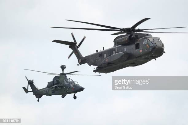Helicopters of the Bundeswehr the German armed forces including a Sikorsky CH53 and a Eurocopter Tiger fly during a special forces simulation of...