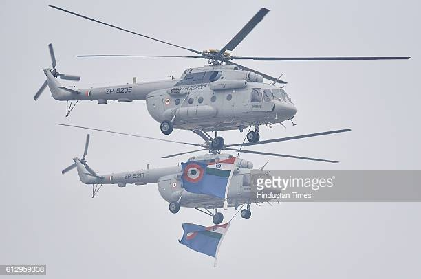 Helicopters of the Indian Air Force show skills during the 84th anniversary of Air Force Day parade rehearsals at the Air Force Station Hindon on...