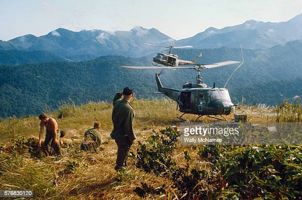 Helicopters on a resupply mission from the 1st Air Cavalry Division fly into a mountaintop outpost manned by soldiers of the Airmobile Division