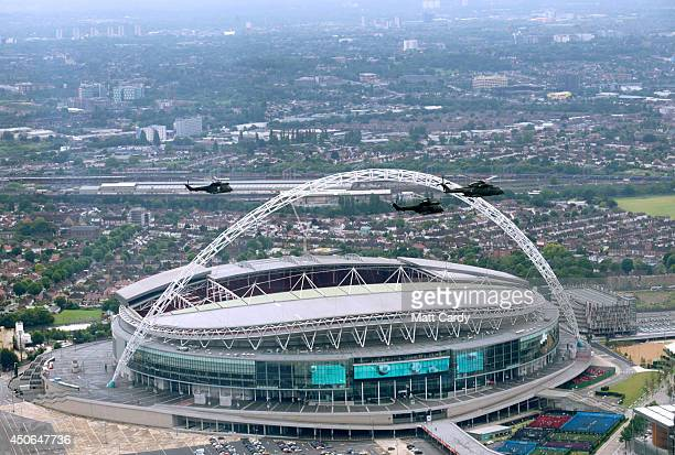 Helicopters pass Wembley Stadium seen from the air on June 14, 2014 in London, England.