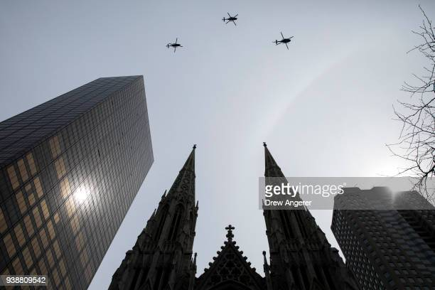 Helicopters perform a flyover at the conclusion of the funeral for New York City firefighter Lt Michael Davidson at St Patrick's Cathedral March 27...