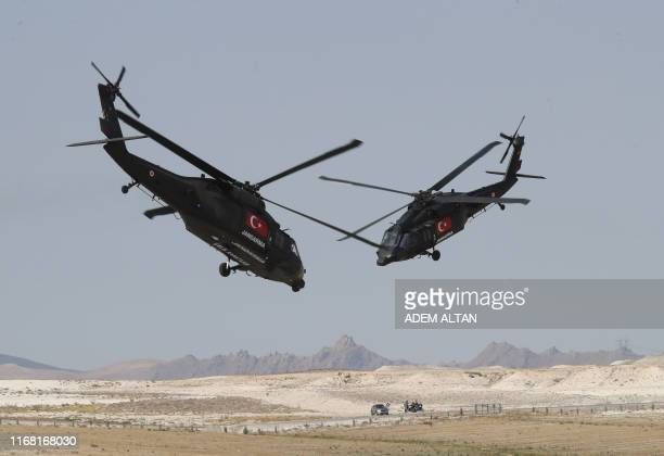 Helicopters perform during the Sivrihisar Airshow in Sivrihisar district of Eskisehir on September 14 2019