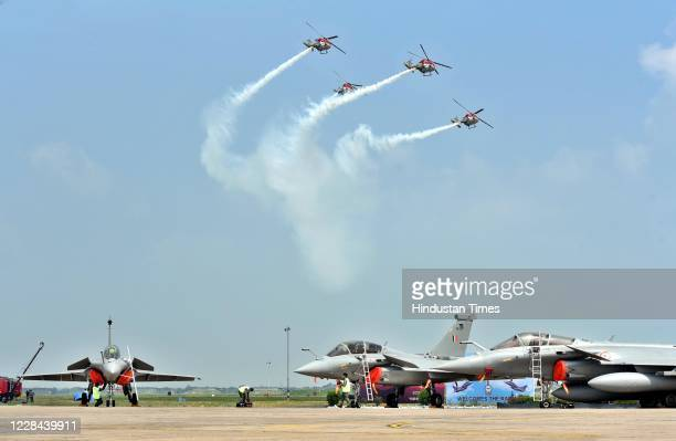 Helicopters 'Sarang' perform during the Rafale induction ceremony on September 10, 2020 in Ambala, India. The aircraft will be part of 17 Squadron,...