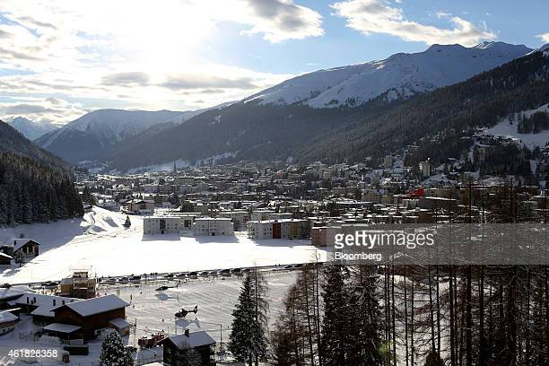 Helicopters stand in the snow on helipads bottom left at the InterContinental hotel Davos operated by InterContinental Hotels Group Plc ahead of the...