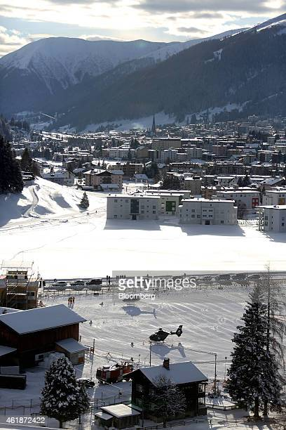Helicopters stand on the helipad at the InterContinental Hotel Davos operated by InterContinental Hotels Group Plc ahead of the World Economic Forum...