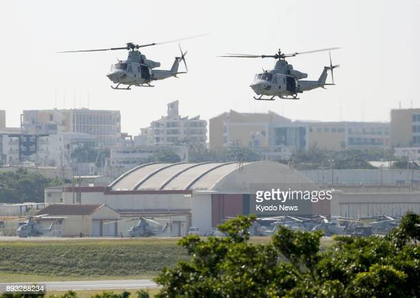 Helicopters take off from the US Marine Corps Air Station Futenma in Ginowan Okinawa Prefecture on Dec 15 two days after a metalframed window fell...