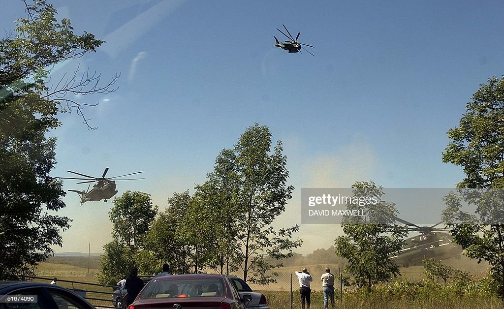 Helicopters touch down in a field near the memoria : News Photo