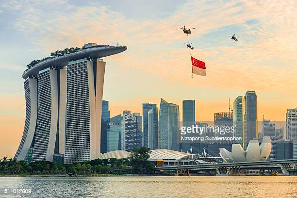 Helicopters with Singapore National Flag over Marina Bay on the rehearsal day of national day performance, Singapore.