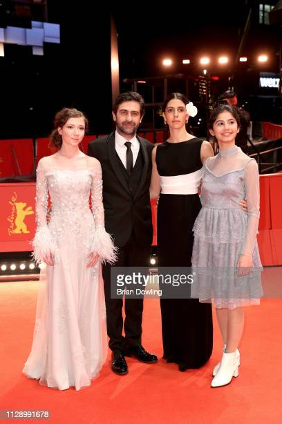 Helin Kandemir Emin Alper Ece Yüksel and Cemre Ebüzziya pose at the A Tale Of Three Sisters premiere during the 69th Berlinale International Film...