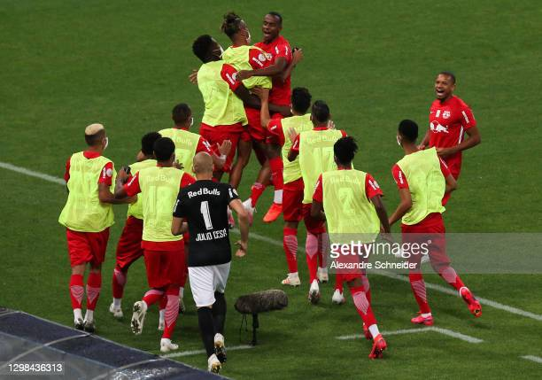 Helinho of Red Bull Bragantino celebrates with his team mates after scoring the first goal of their team a match between Corinthians and Red Bull...