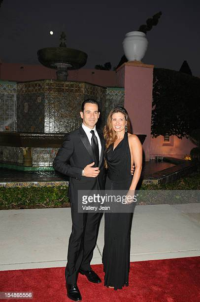 Helio Castroneves and Adriana Henao arrive at 23rd Annual Chris Evert/Raymond James ProCelebrity Tennis Classic Gala at Boca Raton Resort on October...