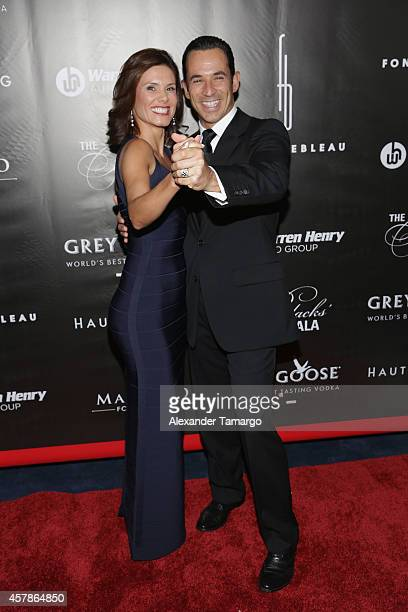 Helio Castroneves and Adriana Henao attend Blacks' Annual Gala at Fontainebleau Miami Beach on October 25 2014 in Miami Beach Florida
