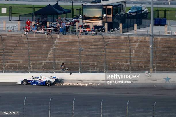 Helio Castroneves driver of the AAA Insurance Team Penske Chevrolet crashes during the Verizon IndyCar Series Rainguard Water Sealers 600 at Texas...