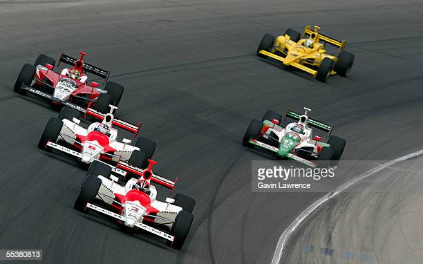 Helio Castroneves driver of the Marlboro Team Penske Dallara Toyota leads Sam Hornish Jr driver of the Marlboro Team Penske Dallara Toyota and Dan...