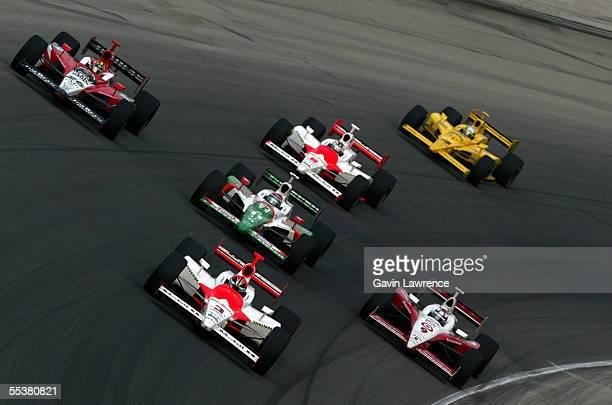 Helio Castroneves driver of the Marlboro Team Penske Dallara Toyota leads Dan Wheldon driver of the Klein Tools/Jim Beam Andretti Green Racing Jim...