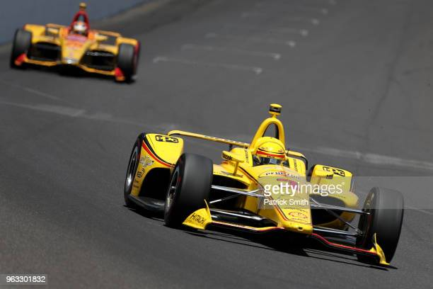 Helio Castroneves driver of the Pennzoil Team Penske Chevrolet races during the 102nd Indianapolis 500 at Indianapolis Motorspeedway on May 27 2018...
