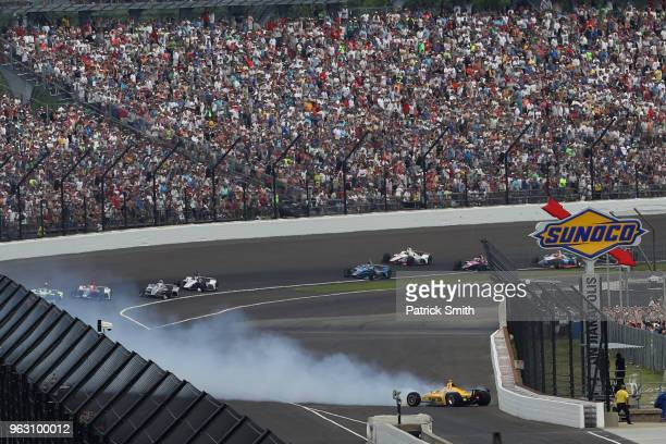 Helio Castroneves driver of the Pennzoil Team Penske Chevrolet crashes during the 102nd Indianapolis 500 at Indianapolis Motorspeedway on May 27 2018...