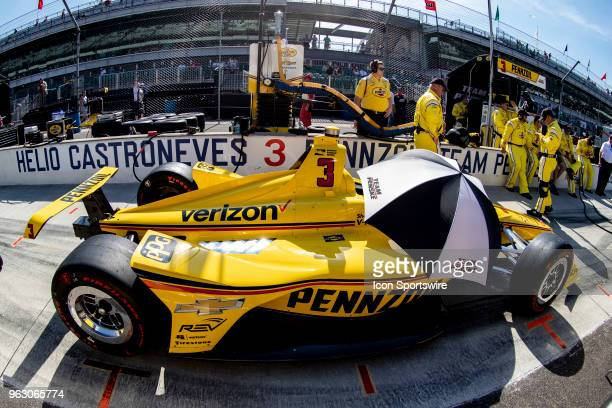 Helio Castroneves driver of the Team Penske Chevrolet car sits in the pit box before going to the grid prior to the running of the 102nd Indianapolis...