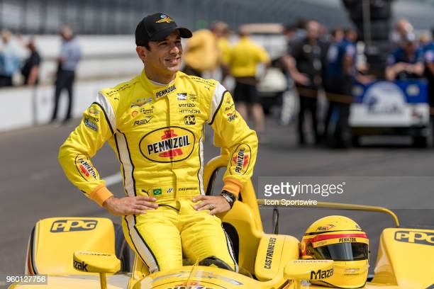 Helio Castroneves driver of the Team Penske Chevrolet poses for photos during Indianapolis 500 qualifications on May 19 at the Indianapolis Motor...