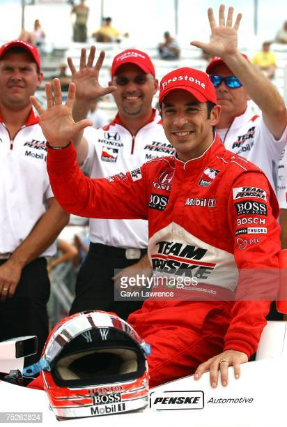 Helio Castroneves driver of the Team Penske Dallara Honda, celebrates his fifth pole position of the year during qualifying for the Indy Racing...