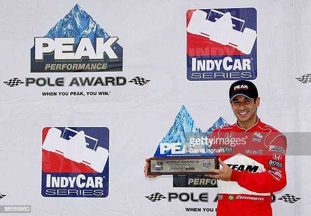 Helio Castroneves, driver of the Team Penske Dallara Honda celebrates Pole Position for the IRL Indycar Series Iowa Corn Indy 250 on June 20, 2009 at...