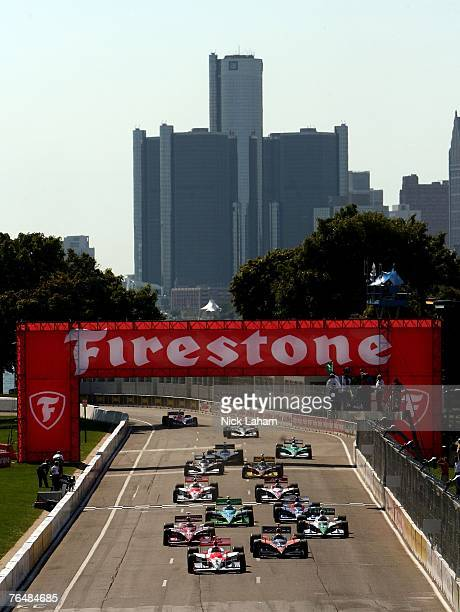 Helio Castroneves driver of the Team Penske Dallara Honda leads the pack into the first turn on the opening lap during the IRL IndyCar Series Detroit...