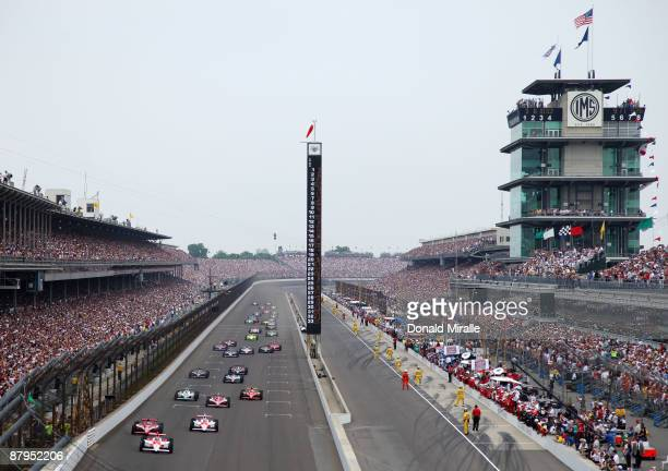 Helio Castroneves driver of the Team Penske Dallara Honda leads the field at the start of the IRL IndyCar Series 93rd running of the Indianapolis 500...