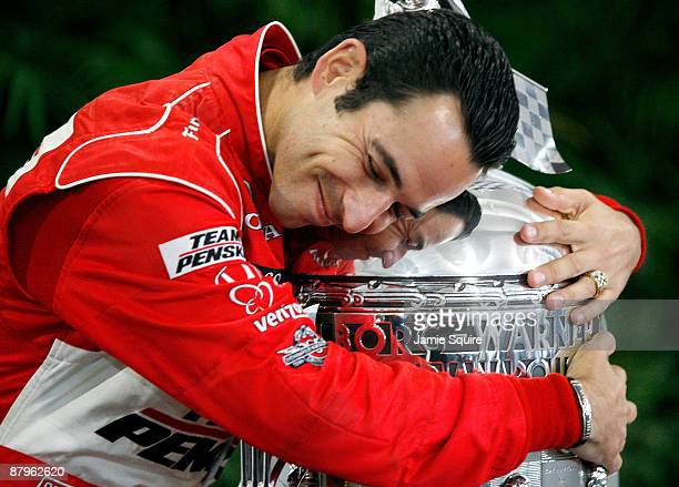 Helio Castroneves driver of the Team Penske Dallara Honda poses with the Borg Warner Trophy following his victory in the 93rd Indianapolis 500 on May...
