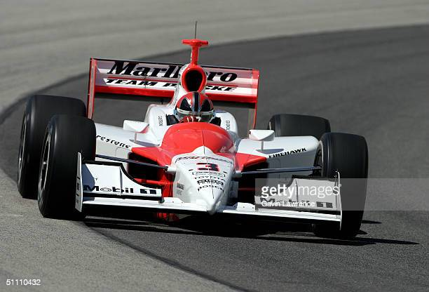 Helio Castroneves drives the Marlboro Team Penske Toyota Dallara during practice for the Indy Racing League IndyCar Series Menards AJ Foyt Indy 225...