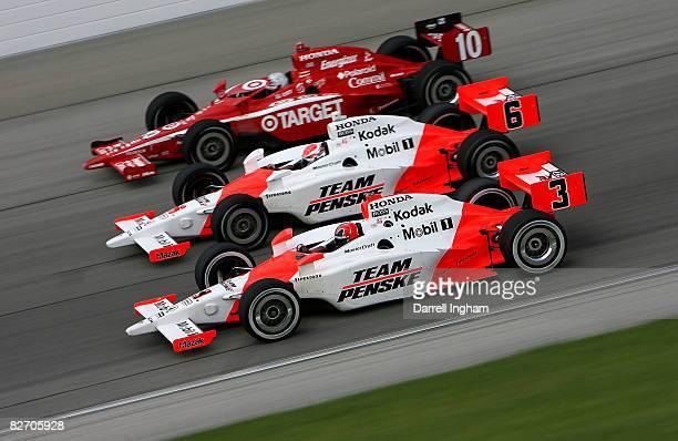 Helio Castroneves drives the Team Penske Dallara Honda alongside team mate Ryan Briscoe in the and Dan Wheldon driving the Target Chip Ganassi Racing...
