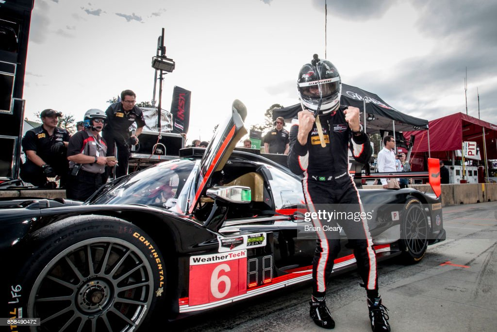 Helio Castroneves, of Brazil, celebrates after winning the pole position for the Motul Petit Le Mans at Road Atlanta on October 6, 2017 in Braselton, Georgia.