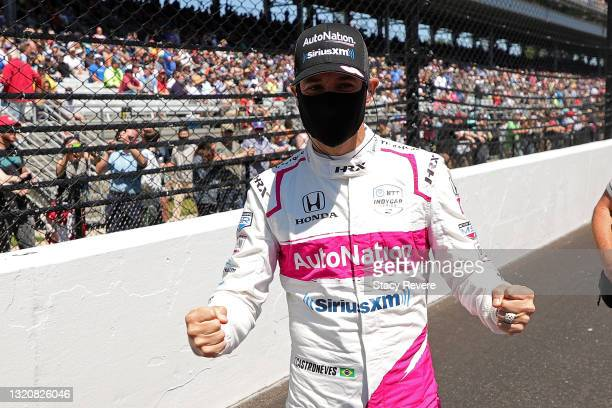 Helio Castroneves of Brazil, driver of the AutoNation/SiriusXM Meyer Shank Racing Honda, stands on the grid prior to the 105th running of the...