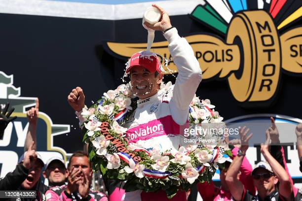 Helio Castroneves of Brazil, driver of the AutoNation/SiriusXM Meyer Shank Racing Honda, celebrates after winning the 105th running of the...