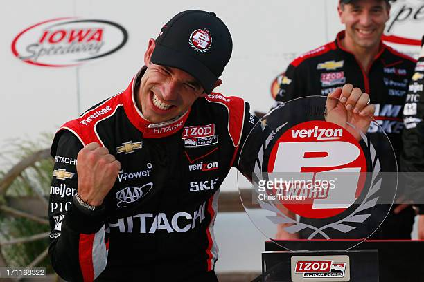 Helio Castroneves of Brazil, driver of the Hitachi Team Penske Chevrolet, celebrates after winning the Verizon P1 pole award for the Iowa Corn Indy...