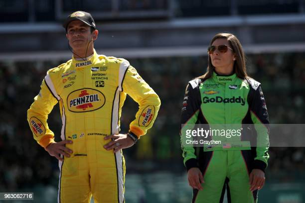 Helio Castroneves of Brazil driver of the Pennzoil Team Penske Chevrolet is introduced with Danica Patrick driver of the GoDaddy Chevrolet prior to...