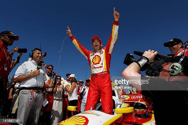 Helio Castroneves of Brazil driver of the Shell VPower/Pennzoil Ultra Team Penske Chevrolet celebrates winning the IZOD IndyCar Series Honda Grand...