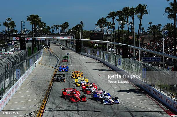 Helio Castroneves of Brazil driver of the Team Penske Chevrolet Dallara right and Scott Dixon of New Zealand driver of the Target Chip Ganassi Racing...