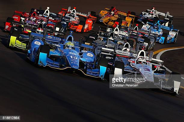 Helio Castroneves of Brazil driver of the Team Penske Chevrolet IndyCar and Tony Kanaan of Brazil driver of the Chip Ganassi Racing Teams Chevrolet...