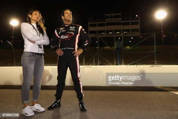 Helio Castroneves of Brazil driver of the Team Penske Chevrolet stands on the grid with girlfriend Adriana Henao after qualifying for the Desert...