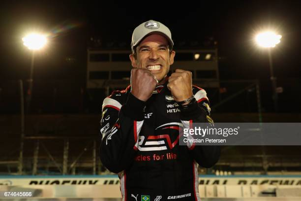 Helio Castroneves of Brazil, driver of the Team Penske Chevrolet celebrates after winning the Verizon P1 Pole Award for the Desert Diamond West...