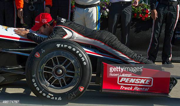Helio Castroneves of Brazil, driver of the Team Penske Dallara Chevrolet, celebrates after winning the Verizon IndyCar Series Chevrolet Indy Dual in...
