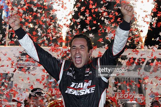 Helio Castroneves of Brazil, driver of the Team Penske Dallara Honda celebrates after winning the IndyCar Series Kentucky Indy 300 at Kentucky...