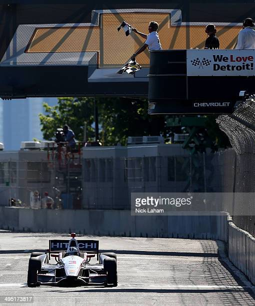 Helio Castroneves of Brazil driver of the Team Penske Dallara Chevrolet takes the checkered flag to win the Verizon IndyCar Chevrolet Indy Dual II at...